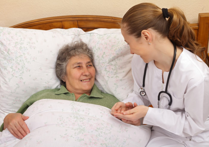 In-home nurse meets with a patient.
